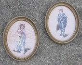 Two Needle Points in Oval Frames