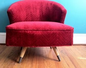 Red velvet Mid Century rotating chair
