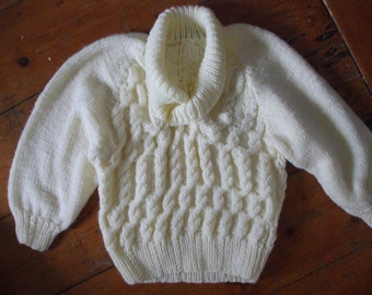 Child's cream acrylic cable Aran handknit sweater