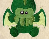 Cthulhu Loves You embroidered feeding bib.