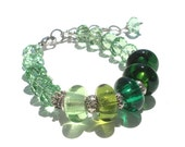 Transparent green lampwork bracelet with extender chain