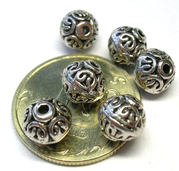 Set of six silver beads