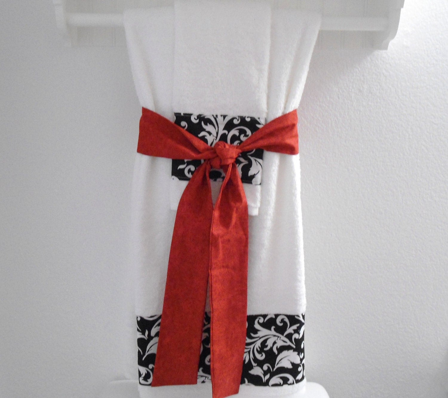 Unavailable listing on etsy for How to tie towels in bathroom
