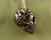 """Skull Necklace with Tribal Motif Bronze Skull Pendant on 24"""" Gold Plated Chain"""
