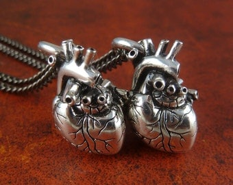 """Two Hearts - Anatomical Heart Necklace - Two Antique Silver Small Anatomical Heart Pendants on 24"""" Gunmetal Chains"""