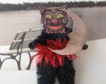 black cat holding his moon man halloween chenille ornaments