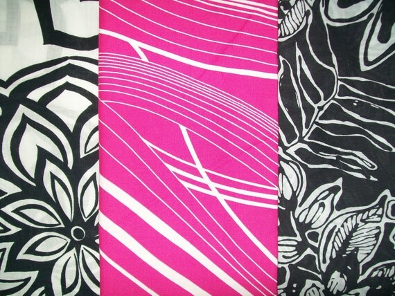 Set of 3 fat quarters of cotton fabrics.