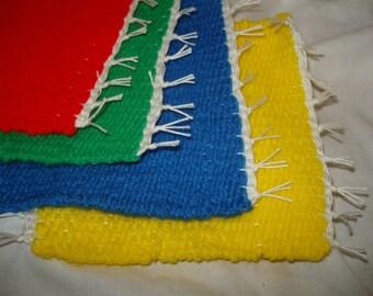 rainbow handmade handwoven coasters home decor mug rugs bright colors primary red green blue yellow