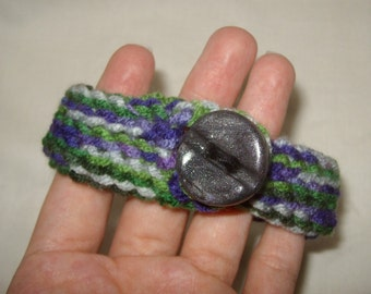 crochet bracelet bangle cuff with handmade button accent green and purple gray screw