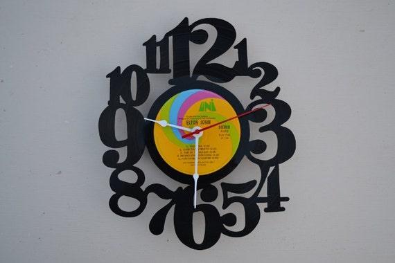 vinyl record clock (artist is Elton John)