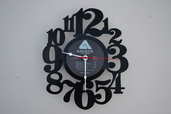 vinyl record clock (artist is Barry Manilow)