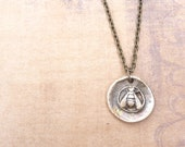 Bee wax seal pendant necklace made in bronze