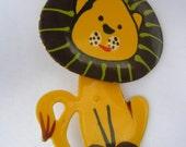 Gold-tone enamel lion pin