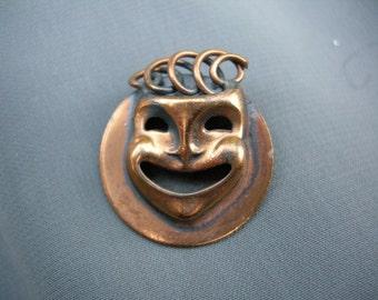 Copper colored face/mask pin