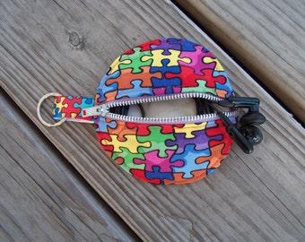 Austim puzzle earbud change holder