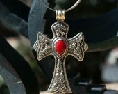 Handcarved Sterling Silver Cross from Bali. Hanging on a multi-strand silver necklace. Item No. 504