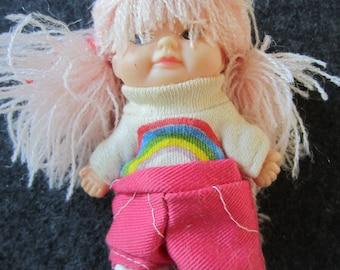 Vintage 1975 U.D. Inc. Hong Kong plastic vinyl doll with string hair and rainbow shirt kitschy cute
