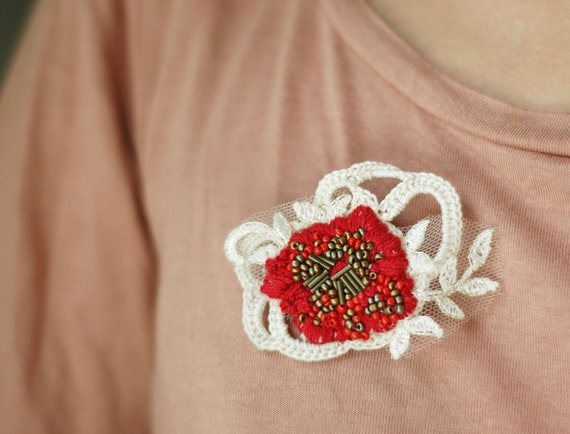 Red embroidered and crochet flower brooch