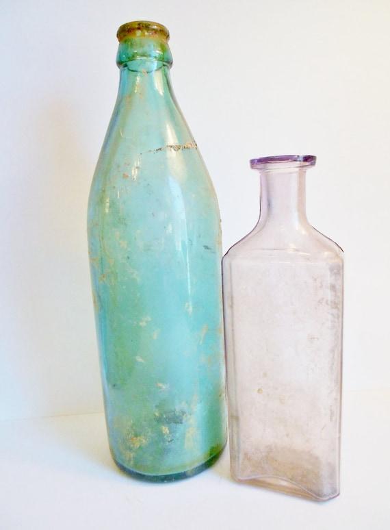 Two antique glass bottles light purple teal for Easy break glass bottles