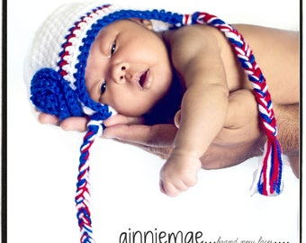 Newborn photography prop earflap hat baby beanie in red, white and blue sparkle with flower.  Sizes nb, 1-3mos, 3-6mos, 6-12mos.