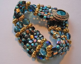 Teal and gold beaded cubist bracelet