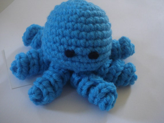 Crocheted little turquoise amigurumi octopus
