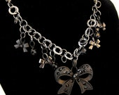 Black Metal Bow With Mini Bow Charms