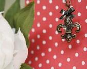 Necklace: Pendant, Fleur de Lis, Black, Bow, Charm, Vintage-Inspired, Antique Brass