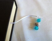 Teal and silver beaded, flower, white ribbon bookmark