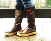 SLUGS Fleece Rain Boot Liners Solid Black with a Black and Red Flower on the Cuff (Sm/Med and Med/Lg).
