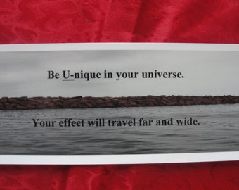 """Bookmark titled """"Be Unique in Your Universe"""""""
