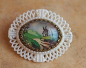Encased Beauty - Tiny Landscape Painting Encased in Intricate antique Brooch
