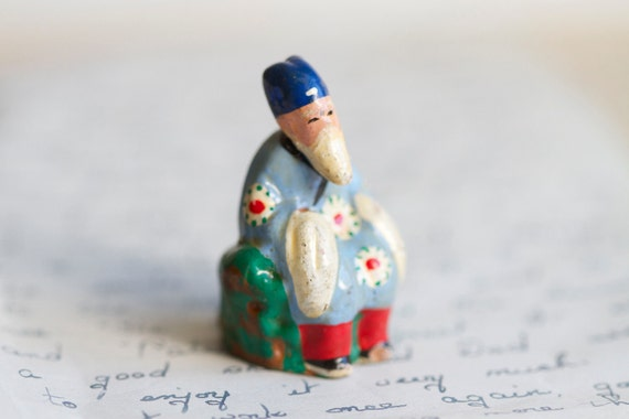 Sitting Wise Man or Dodo - Tiny Colorful Ceramic Figurine