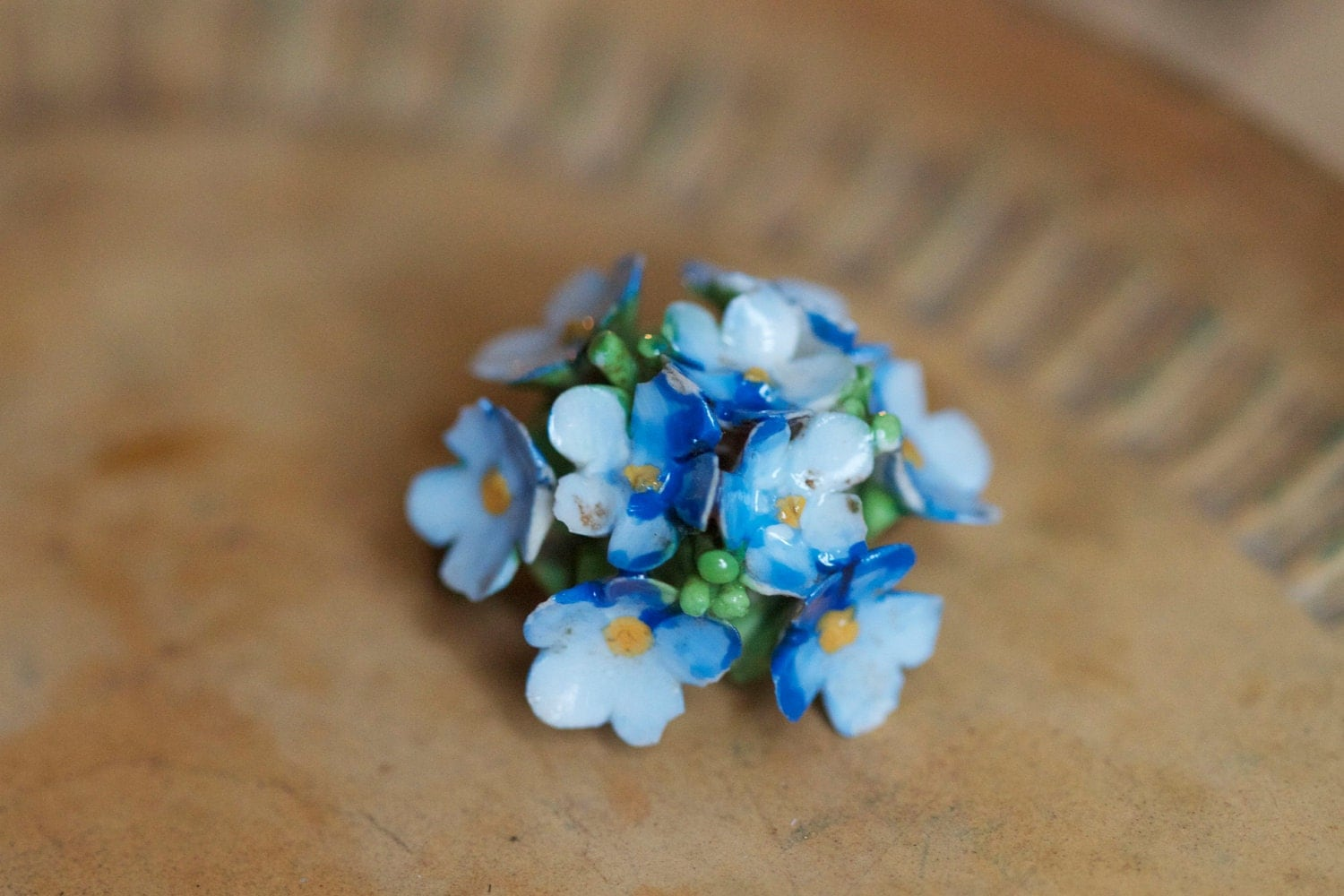Ceramic bouquet of tiny blue flowers made in england by for How are blue roses made