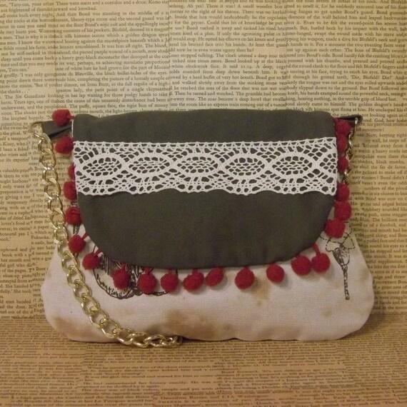 Pom pom and lace handbag with chain strap.