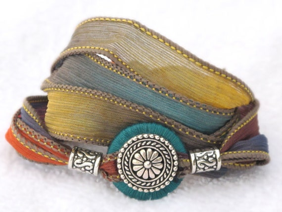 Silk Ribbon Whirly Wrap Bracelet southwest colors of sand turquoise sunset and gold with silver focal piece refined elegant desert colors