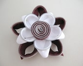 White and aubergine zipper flower brooch