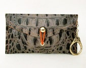 d.nvlp phone case & key chain  taupe with orange stitching