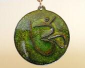 OM cloisonne on enameled copper pendant, metallic green on crackle black
