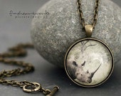 africa is a feeling ... rhinocerous photograph in an antique brass pendant