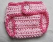 newborn size diaper cover in pinks