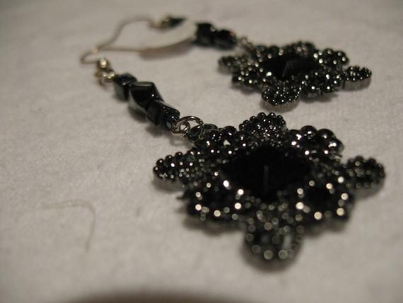black metal and fiberglass earrings