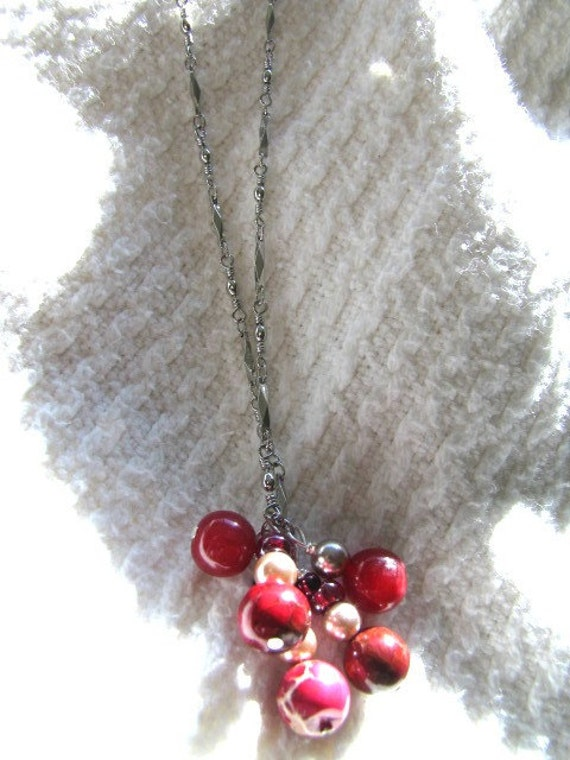 Misc. coral and red marble pendant on a silver chain necklace