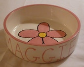personalized dog or cat bowl with a pink daisy in the center and your pets name