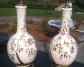 on hold for Clairbest Pair of Elegant Handpainted Chinoiserie Lamps with Brass Bases.