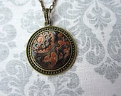 Steampunk/Industrial Pendant - Gold and Copper Gear on Black in Brass Setting.