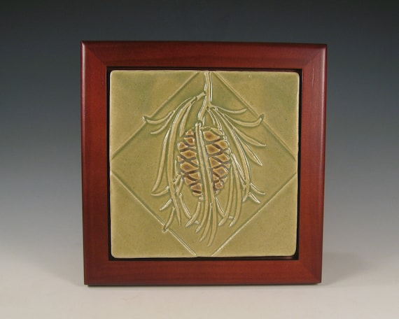 Pinecone Design Tile in rosewood finish frame