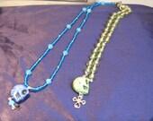 Mardis Gras or Dias de los Muertos green and blue skull necklaces