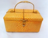 Vintage Murray Kruger purse.  Handbag shaped like a gift present.  Orange snakeskin pattern.
