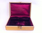 Vintage Farrington jewelry box.  Gold exterior.  Small.  Gorgeous dark purple velvet and satin lining.